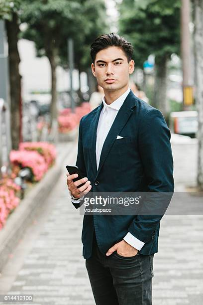 Phone in the Hands of an Asian Businessman