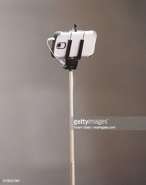 A phone on a selfie stick