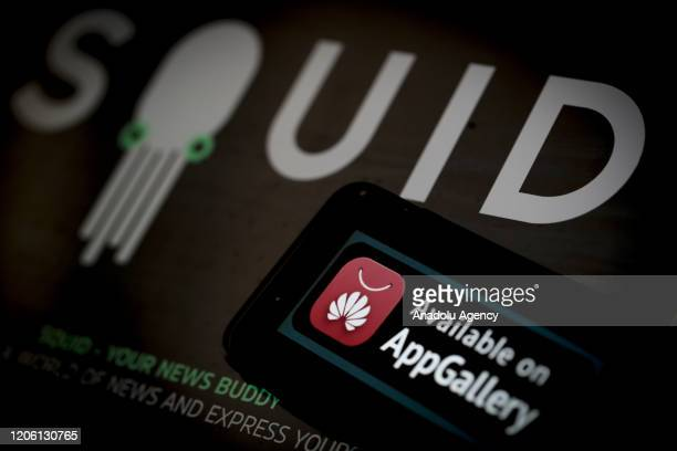 A phone screen displays telecommunications equipment company 'Huawei' icon with 'Squid' news app logo in back of it in Ankara Turkey on March 08 2020...