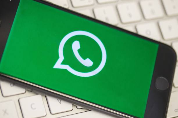 A phone screen over a keyboard displays the logo of WhatsApp applications in Ankara Turkey on August 28 2018
