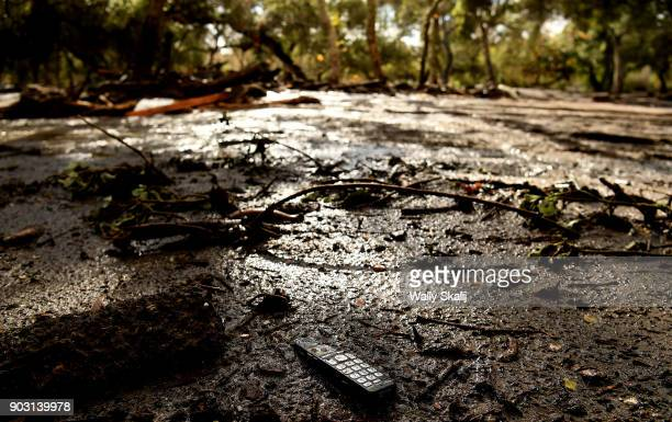 A phone sits in the mud along along Olive Mill Road in Montecito after a major storm hit the burn area January 9 2018 in Montecito California