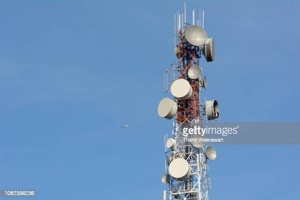 phone transmitter antenna on blue sky - tower stock pictures, royalty-free photos & images