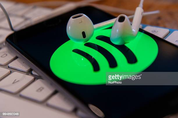 A phone with a Spotify music application is seen in this photo illustration on July 9 2018