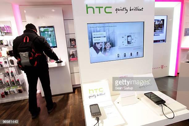HTC phones lie on display at a shop of German telecommunications provider Deutsche Telekom on February 23 2010 in Berlin Germany Deutsche Telekom is...