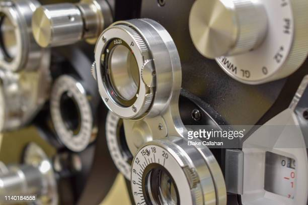 phoropter close-up - eye test equipment stock pictures, royalty-free photos & images