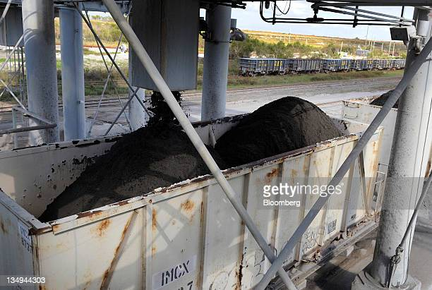 Phosphate rock is loaded into railroad cars to be transported to the Mosaic Co fertilizer chemical plant in Tampa Florida US on Friday Dec 2 2011...