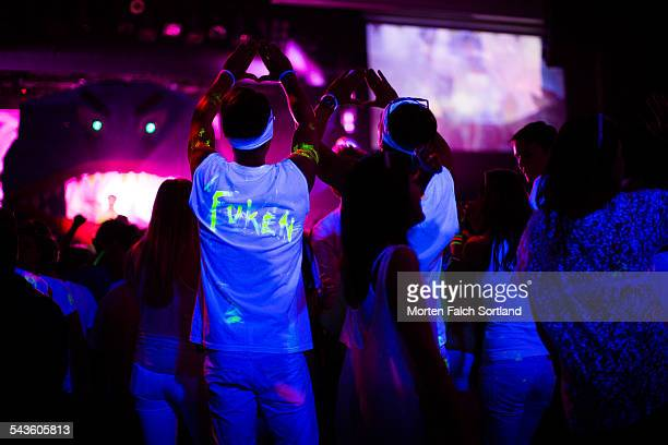 phosphorescent crowd - phosphorescence stock pictures, royalty-free photos & images