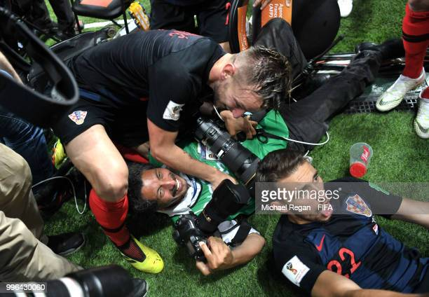 A photgraghes is knocked over by Croatia's player celebrating the second goal during the 2018 FIFA World Cup Russia Semi Final match between England...