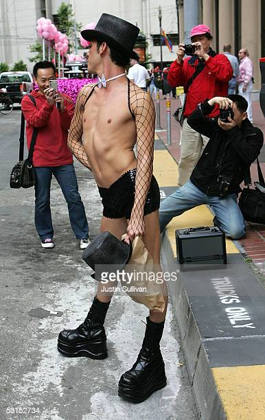 Photgraphers take a photo of a man before the start of the 2005 San Francisco Pride Parade June 26, 2005 in San Francisco, California. Tens of...