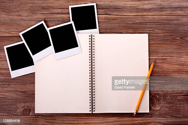 Photo album with blank photo prints