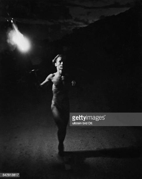Photo based on Leni Riefenstahl's book: 'Beauty in the Olympic Fight'; the Olympic torch bearer crossing the Thermopylae pass in Greece - August...