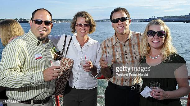 Photo by Gordo Chibroski/Staff Photographer Thursday July 14 2011 Snapshots from 40Under40 event on Casco Bay LR Scott Townsend Scarborough Sarah and...