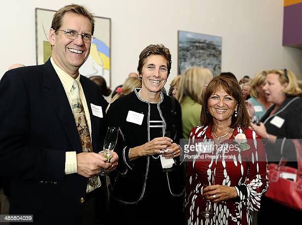 Photo by Gordon Chibroski Staff Photographer Andrew Geoghegan left Gloria Pinza and Kathie Leonard an award recipient