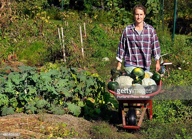 Photo by Gordon Chibroski Staff Photographer Tuesday September 23 2008 Tracy Weber of North Yarmouth wheels a load of freshly picked Blue Hubbard and...