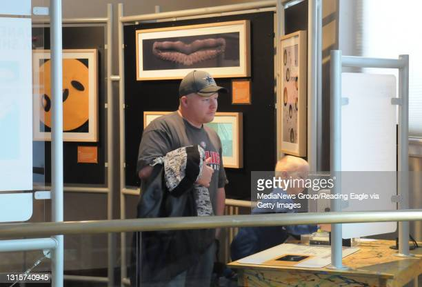 Photo by Harold Hoch - New Museum Exhibits - The Science and Art exhibit found the interest of Tim Kistler of Newmansville and his son Maddox...