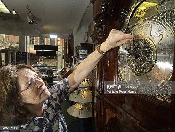 Photo by John Ewing/Staff Photographer Friday October 30 2009 Jill Guyot owner of Swiss Time on Exchange Street in Portland resets the time on a...