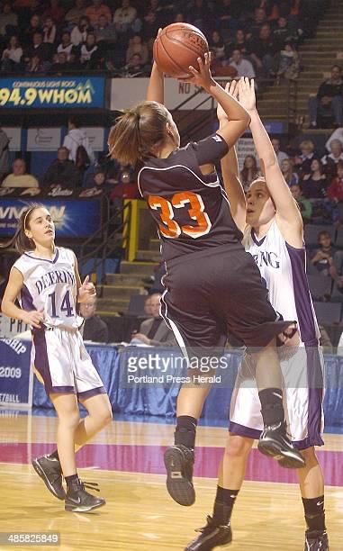 Photo by John Ewing/Staff Photographer Saturday February 212009 Deering vs Biddeford girls in regional final game Biddeford's Lauren Rousseau goes up...