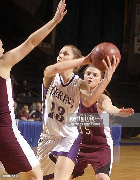 Photo by John Ewing/Staff Photographer Thursday February 19 2009 Deering vs Noble girls semifinal tournament game Deering's Jordan Cuddy looks for a...