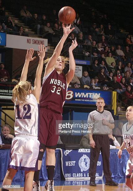 Photo by John Ewing/Staff Photographer Thursday February 19 2009 Deering vs Noble girls semifinal tournament game Noble's Sloane Sorrell shoots a...