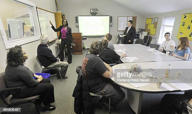 Photo by John Ewing/staff photographer Tuesday May 17 2011 Carine Rugema Stubbs a Key Bank employee teaches financial literacy classes for students a...