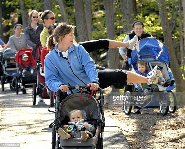 Photo by John Patriquin/Staff Photographer Catherine Culley and her daughter Quinn 11 months lead a group of mothers along an exercise path in...