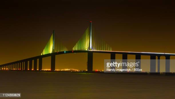 photo by: randy imagesbyk / 500px - sunshine skyway bridge stock photos and pictures