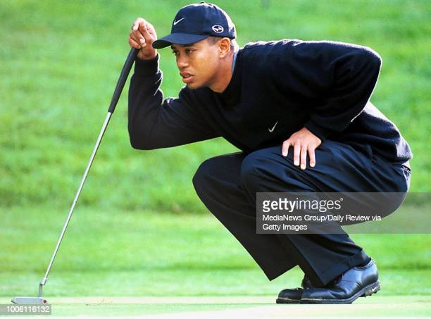 photo by ron lewis/staff 2/3/00 hayward daily review#13#13Tiger Woods studies the angle of the 5th hole green at Poppy Hills during Thursday's first...