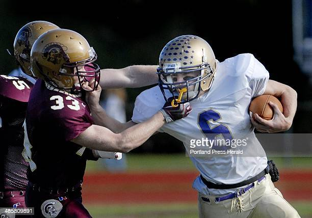 Photo by Shawn Patrick Ouellette/Staff Photographer John Remmes of Thornton Academy tries to bring down Cheverus quarterback Peter Gwilym Gwilym had...