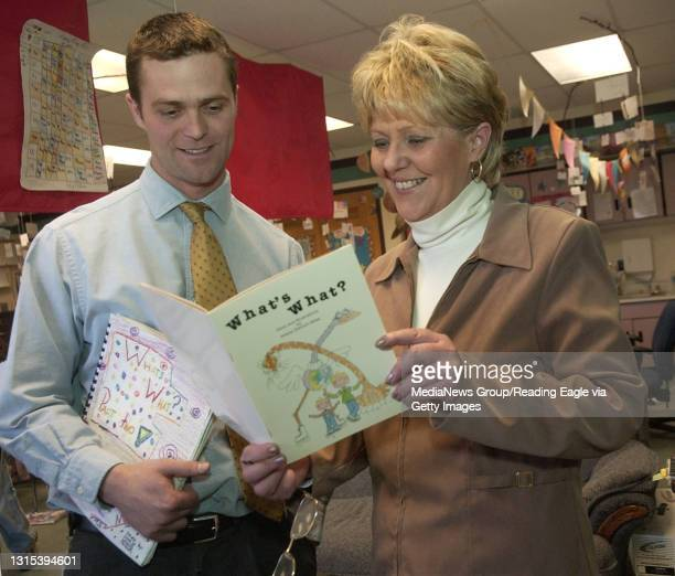 Photo by Tim Leedy 3/30/07Wyomissing Hills Elementary 3rd grade teacher Christopher Miller and his mother Arlene look over a book Arlene created more...