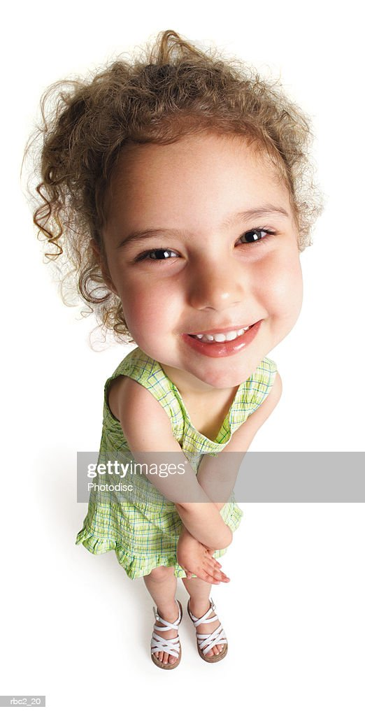 photo caricature from a birdseye view of a cute curly haired girl twisting her arms and smiling upwards : Stockfoto