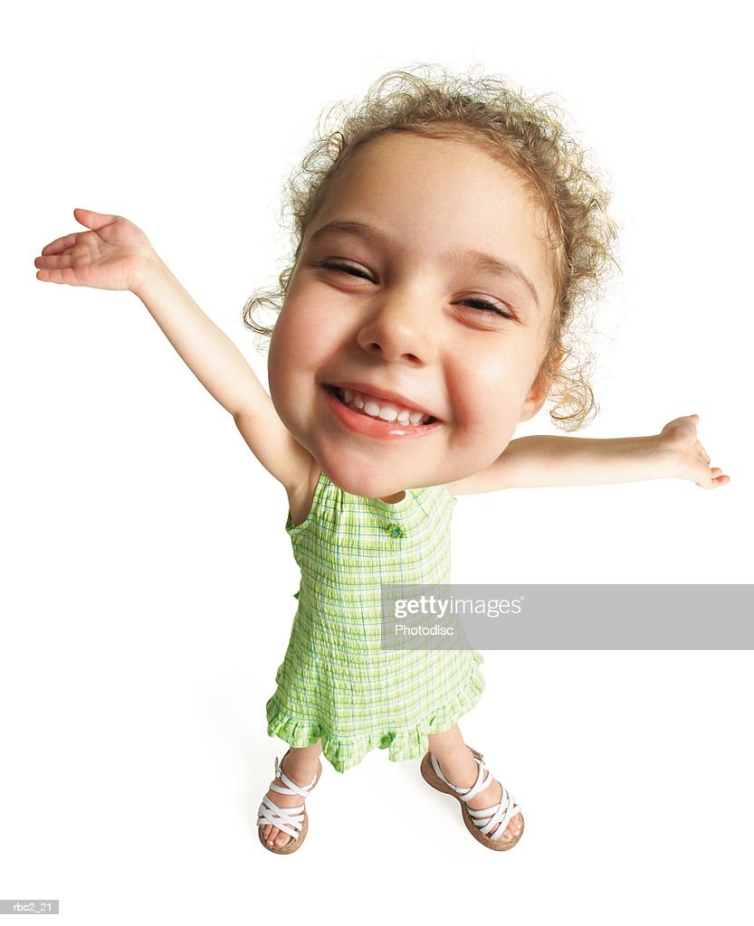photo caricature from a birdseye view of a cute curly haired girl smiling and extending her hands upward in a ta-da motion : Stockfoto