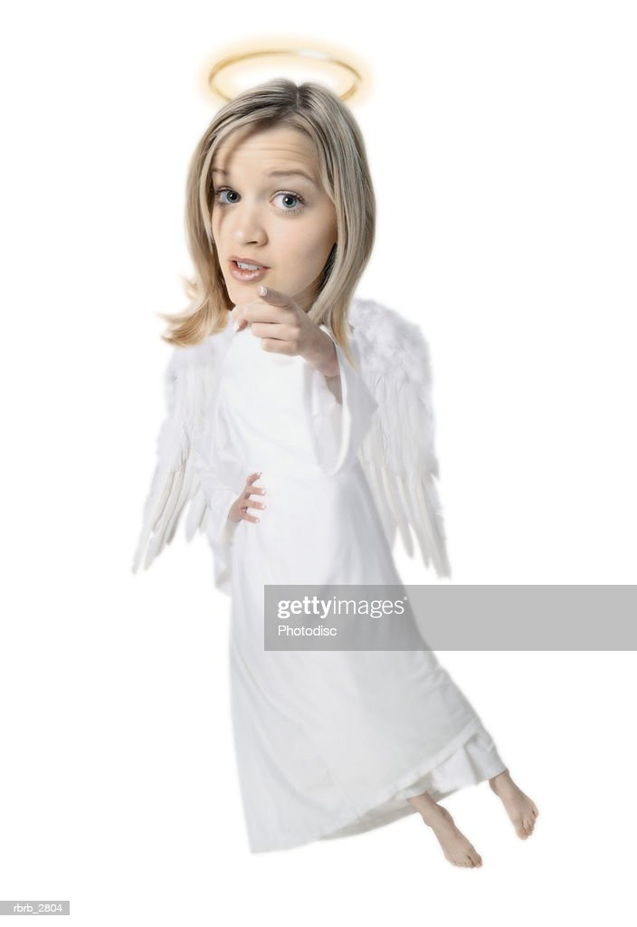 photo caricature of a blonde angel with wings and a halo as she points at the camera : Foto de stock