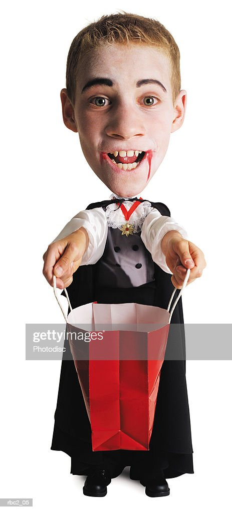 photo caricature of a caucasian in his vampire costume with his bag opened and extened in front of him for a treat : Stockfoto
