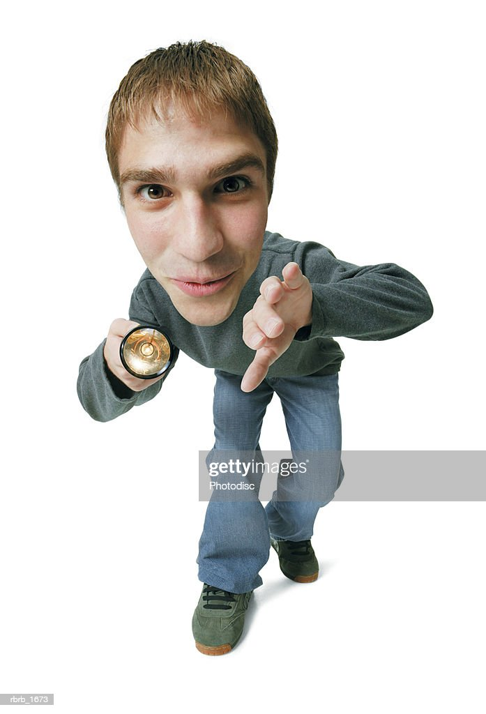 photo caricature of a caucasian male teen as he examines things with a flashlight : Stockfoto