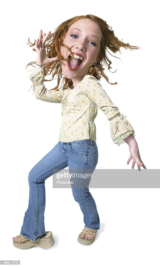 photo caricature of a caucasian redheaded teenage girl as she playfully dances : Stock Photo
