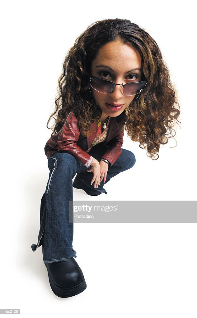 photo caricature of a female teenager wearing sunglasses, and  sitting on her foot with her leg extended forward : Stockfoto