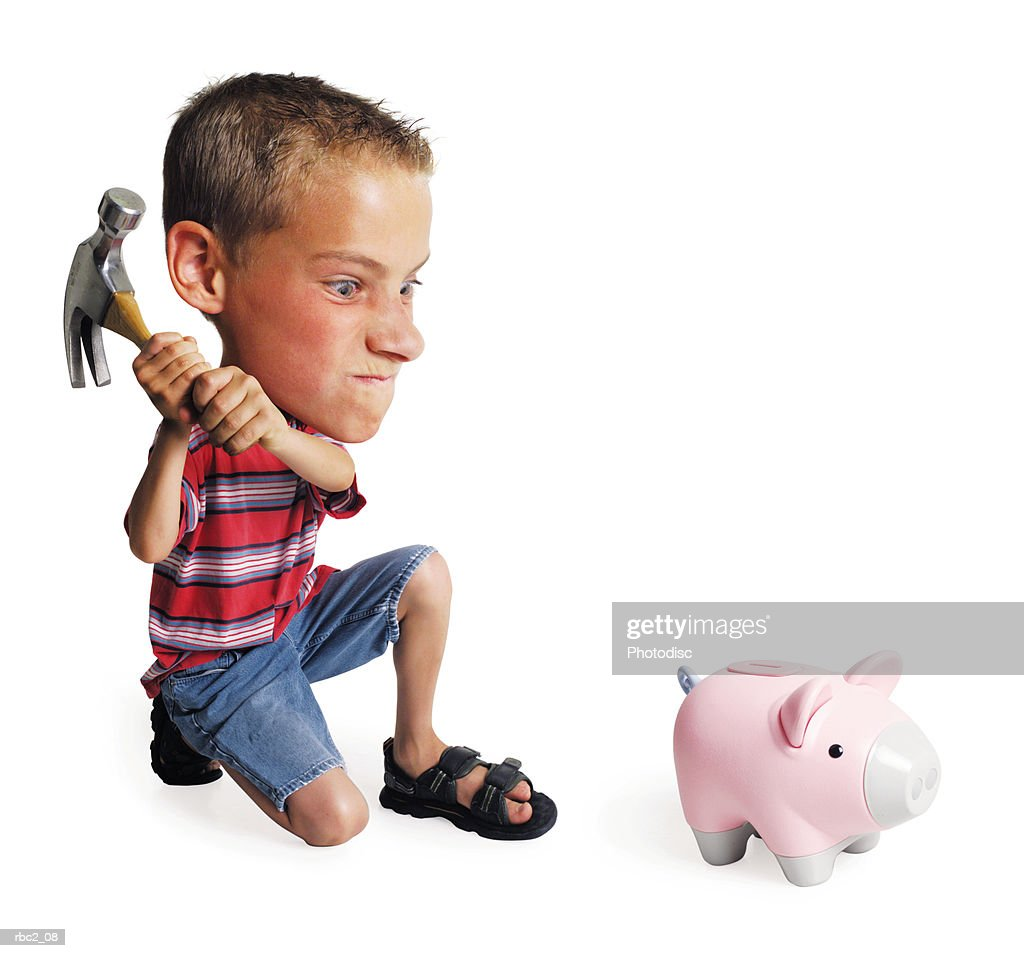 photo caricature of a little boy breaking his piggy bank with a hammer : Stockfoto