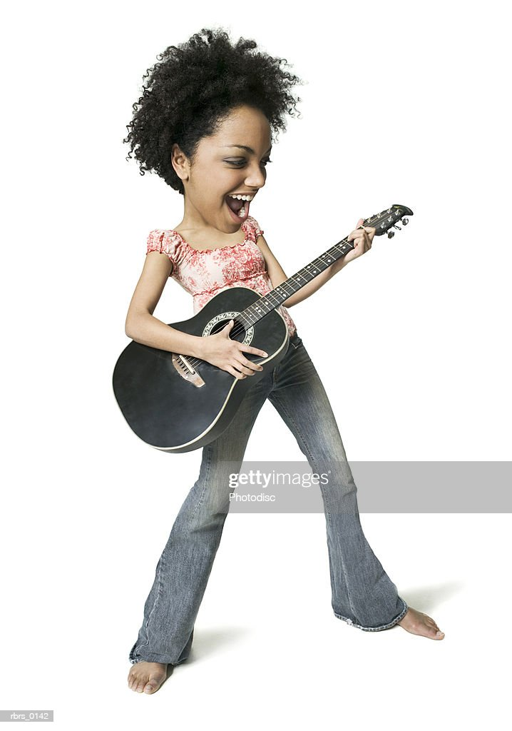 photo caricature of a young adult woman as she plays the guitar : Foto de stock