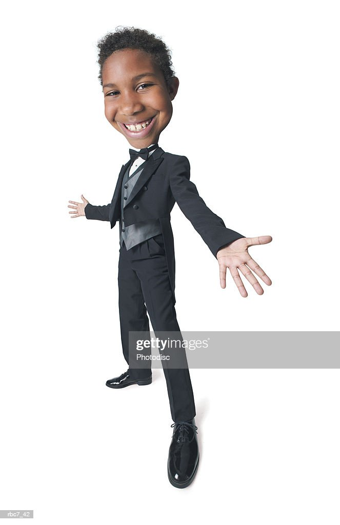 photo caricature of a young african american boy dressed in a tuxedo as he tosses out his arms and smiles brightly : Stockfoto