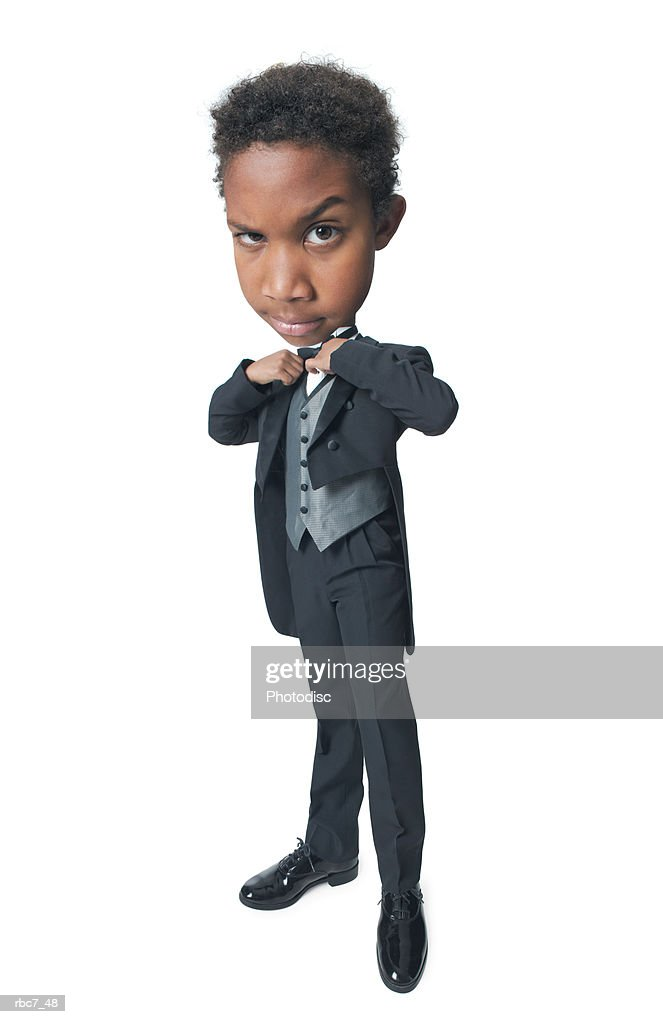 photo caricature of a young african american boy dressed in a tuxedo as he straightens his bow tie : Stockfoto