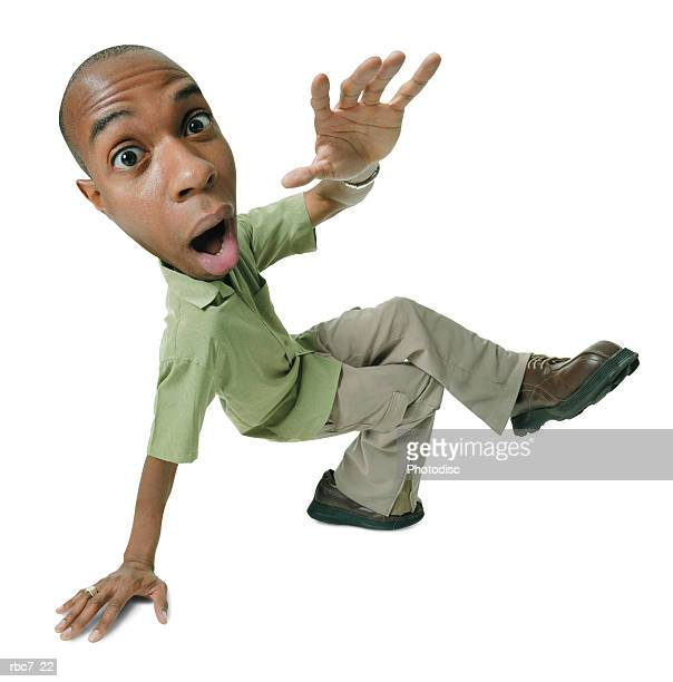 photo caricature of a young african american man in a green shirt as he strikes a fun break dancing pose