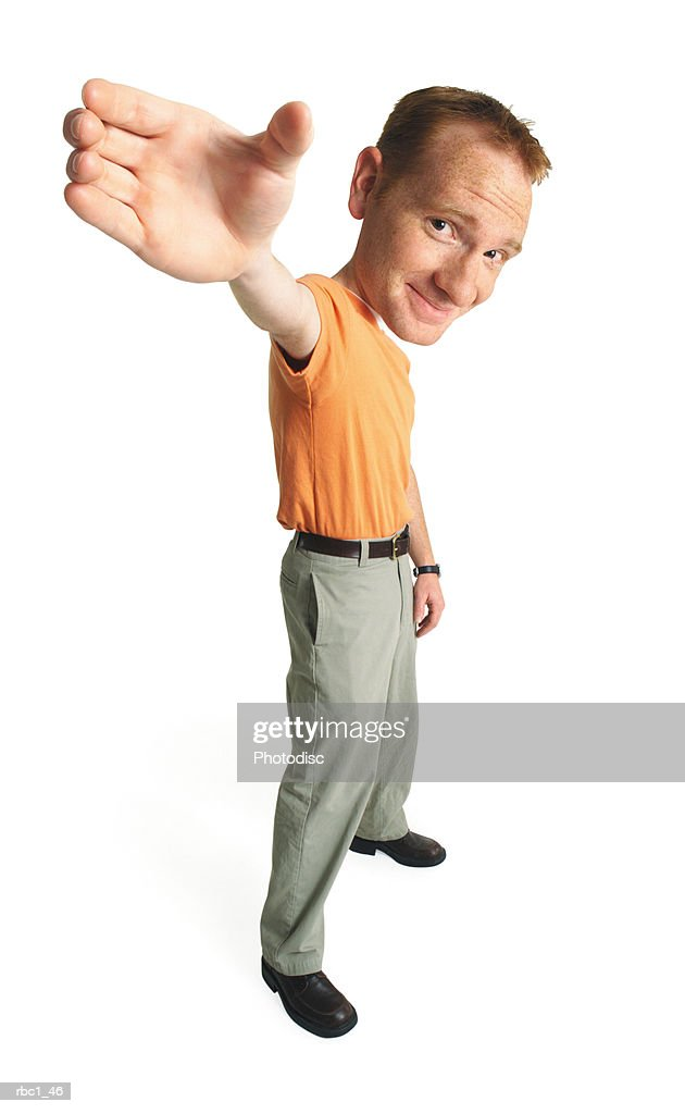 photo caricature of a young caucasian male in an orange t-shirt stands smiling smugly as he raises his hand up into the air : Stockfoto