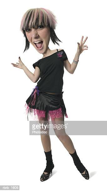 photo caricature of a young caucasian woman in a retro punk outfit as she flashes a funny face