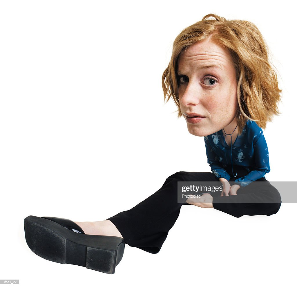 photo caricature of a young caucasian woman in black pants and a turquoise blouse sits with her leg extended with a confused look on her face : Stockfoto