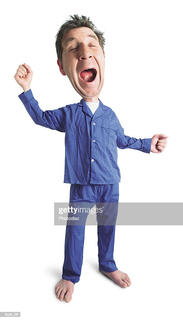 photo caricature of an adult caucasian male in his blue pajamas as he yawns and stretches before bed : Stockfoto