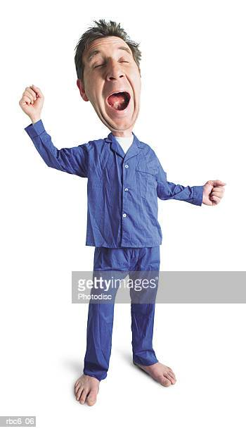 photo caricature of an adult caucasian male in his blue pajamas as he yawns and stretches before bed