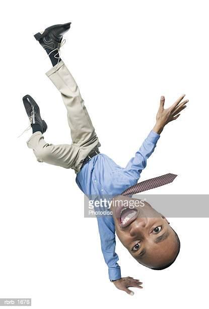 photo caricature of an african american business man as he spins into a cartwheel - personas cabeza grande fotografías e imágenes de stock