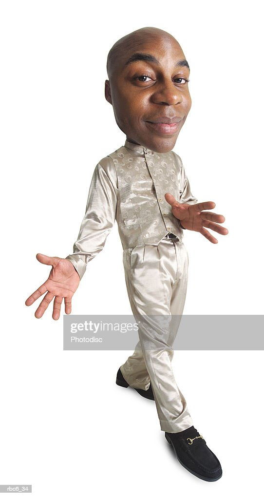 photo caricature of an african american man in a tan outfit srtuts smugly as to be noticed by all : ストックフォト