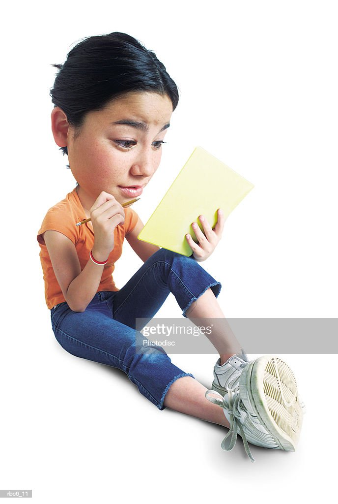 photo caricature of teenage asian girl as she sits with her notebook and pencil and attempts to study : Stockfoto