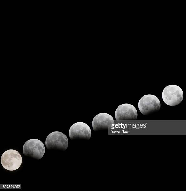 A photo composite of a partial lunar eclipse on August 7 2017 in Srinagar the summer capital of Indian Administered Kashmir Astronomers in India were...